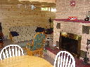 Family room on lower walkout level of Alpine Snow Cabin. Features natural wood burning fireplace.