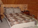 Guest bedroom on second level of Alpine Snow Cabin. Bedroom has view of the golf course.