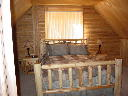 Master bedroom on second level of Alpine Snow Cabin.